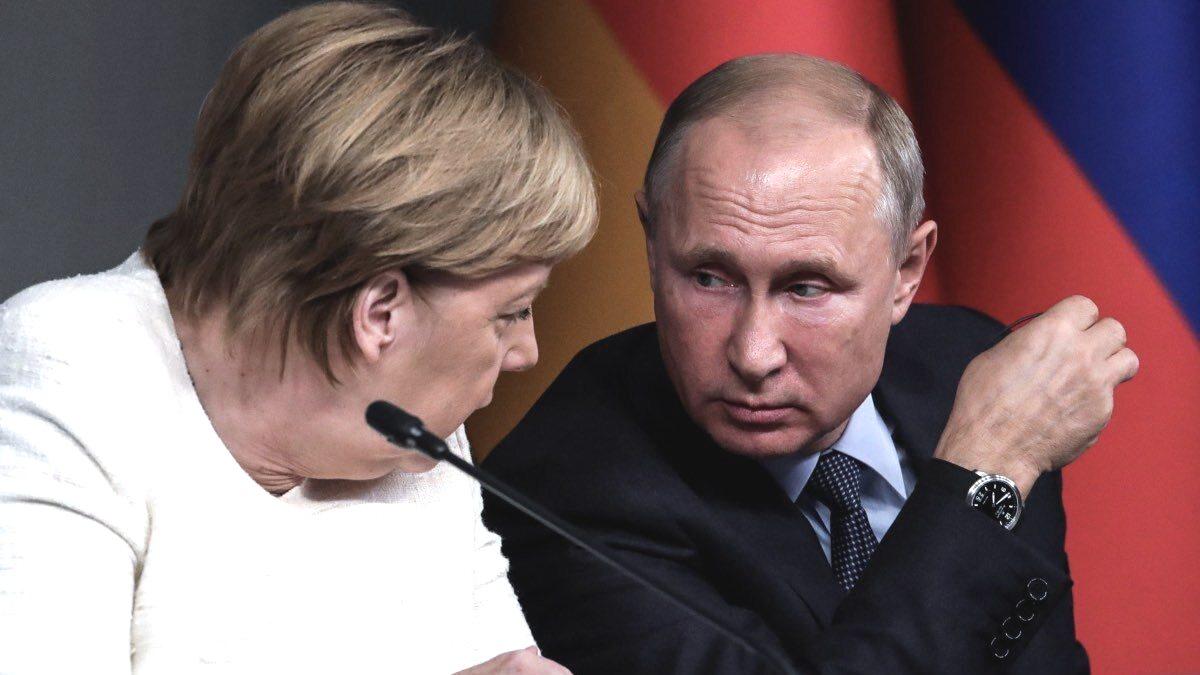 Меркель назвала Путина победителем на встрече в Париже