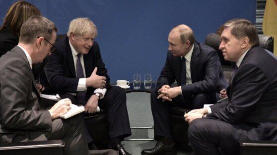 Путин в Берлине впервые лично встретился с Джонсоном