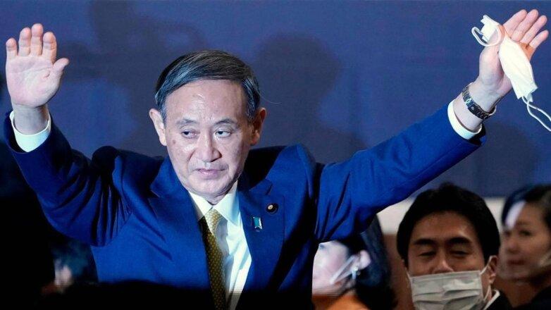 новый премьер Японии Ёсихидэ Суга