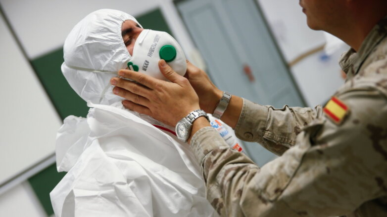 Испания коронавирус военный вирусолог